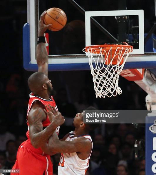 Ivan Johnson of the Atlanta Hawks scores two in the third against Iman Shumpert of the New York Knicks at Madison Square Garden on April 17 2013 in...