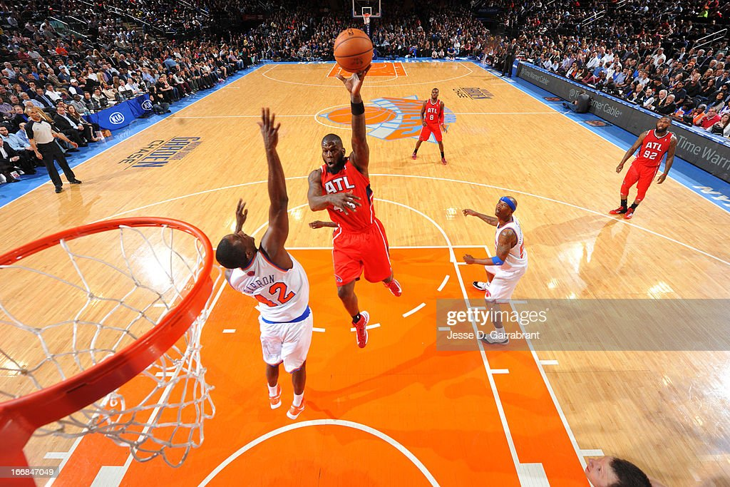 Ivan Johnson #44 of the Atlanta Hawks shoots a layup against Earl Barron #42 of the New York Knicks on April 17, 2013 at Madison Square Garden in New York City, New York.