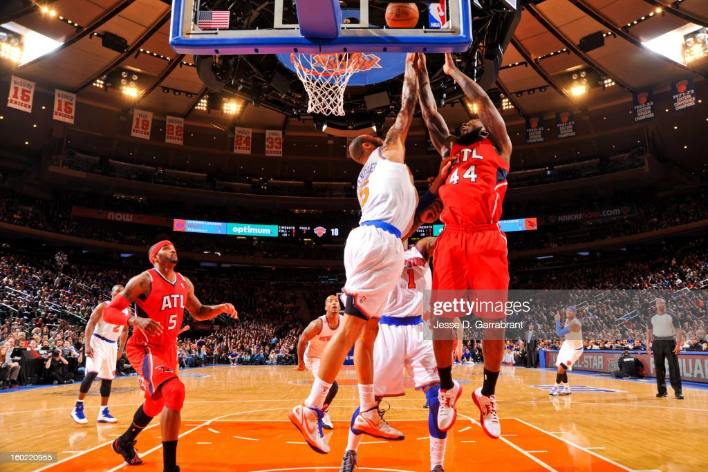 Ivan Johnson #44 of the Atlanta Hawks shoots a layup against Tyson Chandler #6 of the New York Knicks at Madison Square Garden on January 27, 2013 in New York, New York.