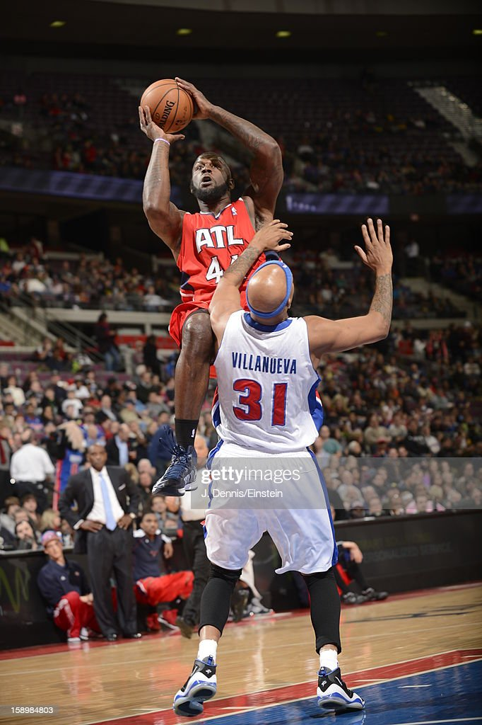Ivan Johnson #44 of the Atlanta Hawks shoots against Charlie Villanueva #31 of the Detroit Pistons during the game on January 4, 2013 at The Palace of Auburn Hills in Auburn Hills, Michigan.