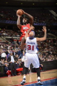Ivan Johnson of the Atlanta Hawks shoots against Charlie Villanueva of the Detroit Pistons during the game on January 4 2013 at The Palace of Auburn...