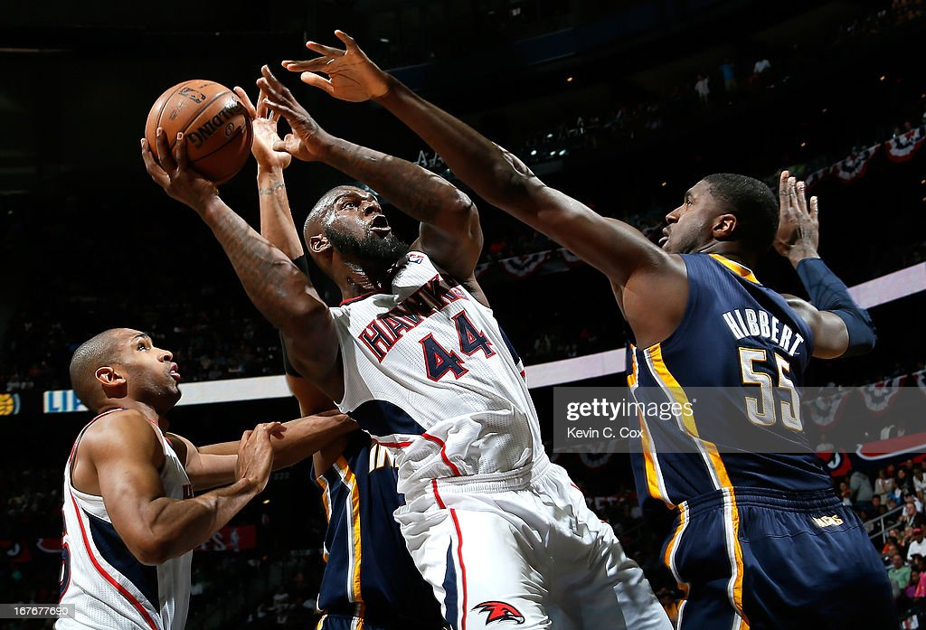 Ivan Johnson of the Atlanta Hawks shoots against David West and Roy Hibbert of the Indiana Pacers during Game Three of the Eastern Conference...
