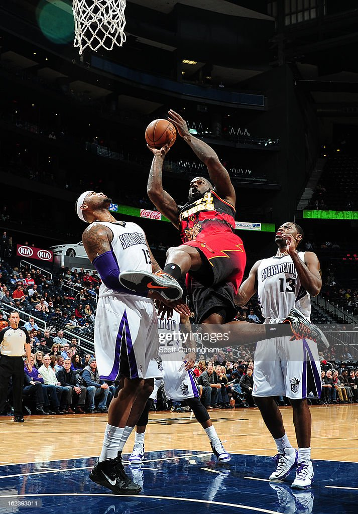 Ivan Johnson #44 of the Atlanta Hawks shoots against DeMarcus Cousins #15 of the Sacramento Kings on February 22, 2013 at Philips Arena in Atlanta, Georgia.