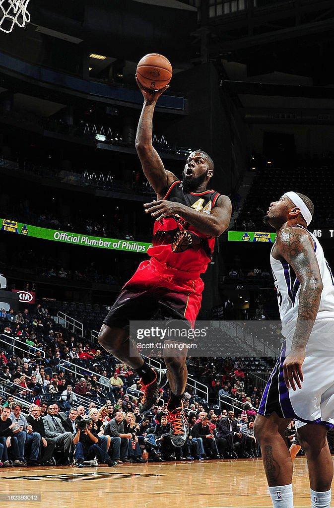 Ivan Johnson #44 of the Atlanta Hawks shoots against DeMarcus Cousins #15 of the Sacramento Kings on February 22, 2013 at Philips Arena in Atlanta, Georgia.