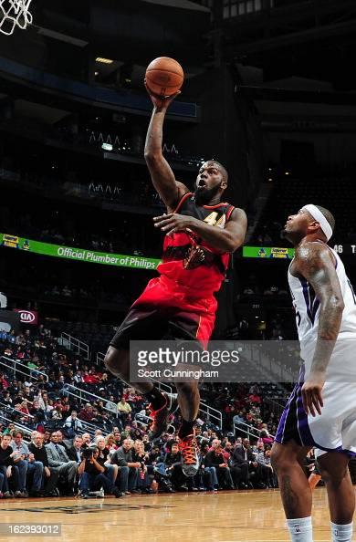 Ivan Johnson of the Atlanta Hawks shoots against DeMarcus Cousins of the Sacramento Kings on February 22 2013 at Philips Arena in Atlanta Georgia...