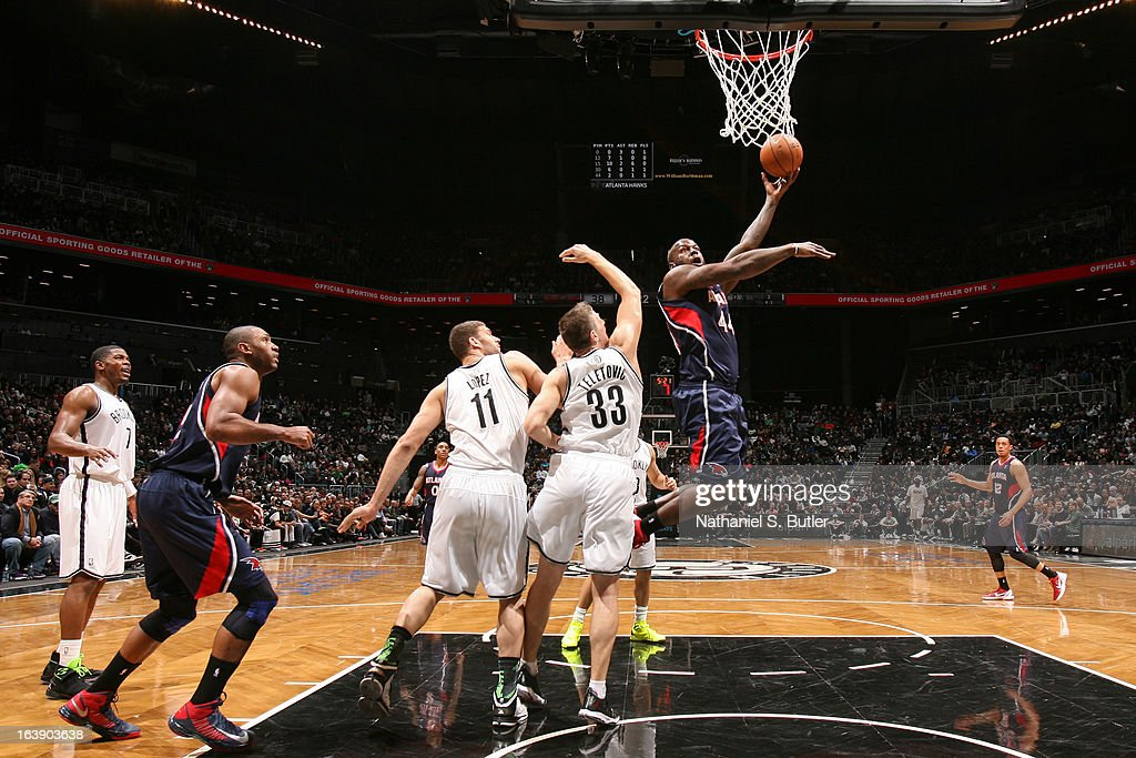 Ivan Johnson #44 of the Atlanta Hawks shoots in the lane against Mirza Teletovic #33 of the Brooklyn Nets on March 17, 2013 at the Barclays Center in the Brooklyn borough of New York City.