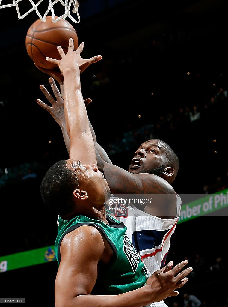 Ivan Johnson #44 of the Atlanta Hawks shoots over Jared Sullinger #7 of the Boston Celtics at Philips Arena on January 25, 2013 in Atlanta, Georgia.