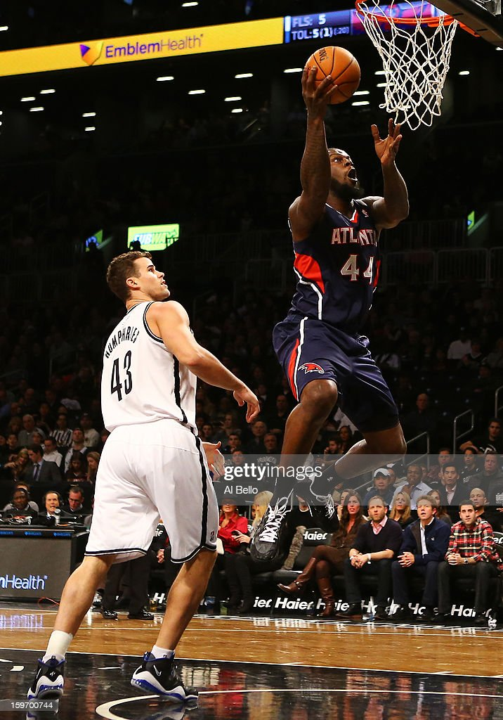 Ivan Johnson #44 of the Atlanta Hawks shoots over Kris Humphries #43 of the Brooklyn Nets in the first quarter of the game at Barclays Center on January 18, 2013 in the Brooklyn borough of New York City.