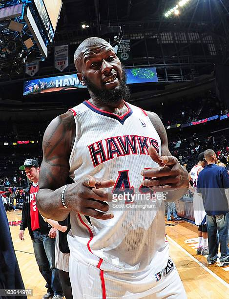 Ivan Johnson of the Atlanta Hawks smiles for the camera after the game against the Los Angeles Lakers on March 13 2013 at Philips Arena in Atlanta...