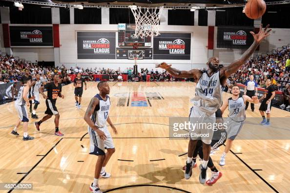 Ivan Johnson of the Dallas Mavericks rebounds the ball against the New York Knicks at the Samsung NBA Summer League 2014 on July 11 2014 at the Cox...