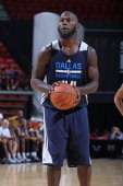 Ivan Johnson of the Dallas Mavericks shoots a free throw against the Minnesota Timberwolves at the Samsung NBA Summer League 2014 on July 12 2014 at...