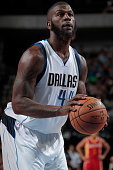 Ivan Johnson of the Dallas Mavericks shoots a free throw against the Houston Rockets on October 7 2014 at the American Airlines Center in Dallas...