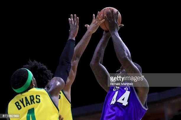 Ivan Johnson of the Ghost Ballers attempts a shot while being guarded by Josh Childress and Derrick Byars of the Ball Hogs during week three of the...