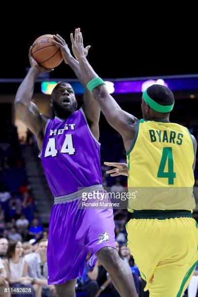 Ivan Johnson of the Ghost Ballers attempts a shot while being guarded by Derrick Byars of the Ball Hogs during week three of the BIG3 three on three...