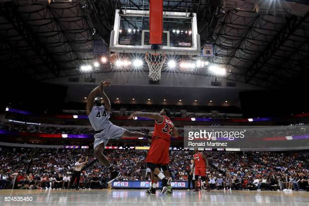 Ivan Johnson of the Ghost Ballers attempts a shot while being guarded by Rashad McCants of Trilogy during week six of the BIG3 three on three...