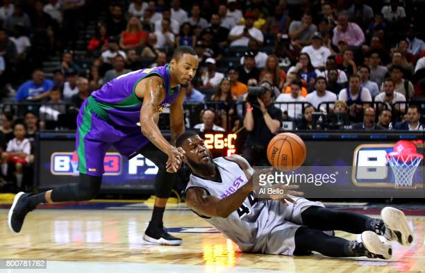 Ivan Johnson of the Ghost Ballers passes against Rashard Lewis of the 3 Headed Monsters during week one of the BIG3 three on three basketball league...