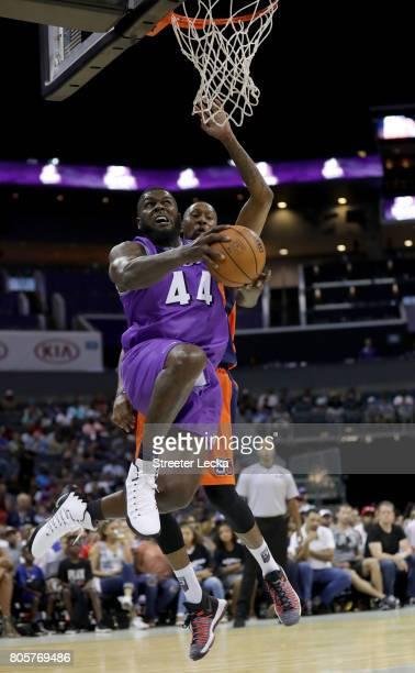 Ivan Johnson of the Ghost Ballers shoots a reverse layup during week two of the BIG3 three on three basketball league at Spectrum Center on July 2...