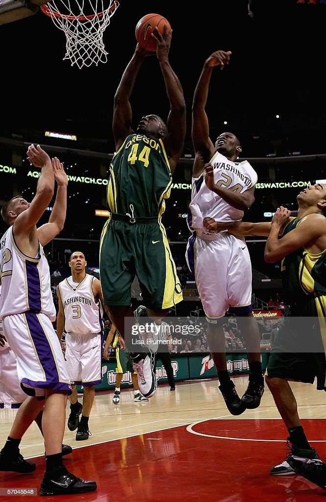 Ivan Johnson #44 of the Oregon Ducks goes to the basket past Mike Jensen #42 and Jamaal Williams #24 of the Washington Huskies in the second half of their quarterfinal game in the 2006 Pacific Life Pac-10 Men's Basketball Tournament on March 9, 2006 at Staples Center in Los Angeles, California. Oregon defeated Washington 84-73.