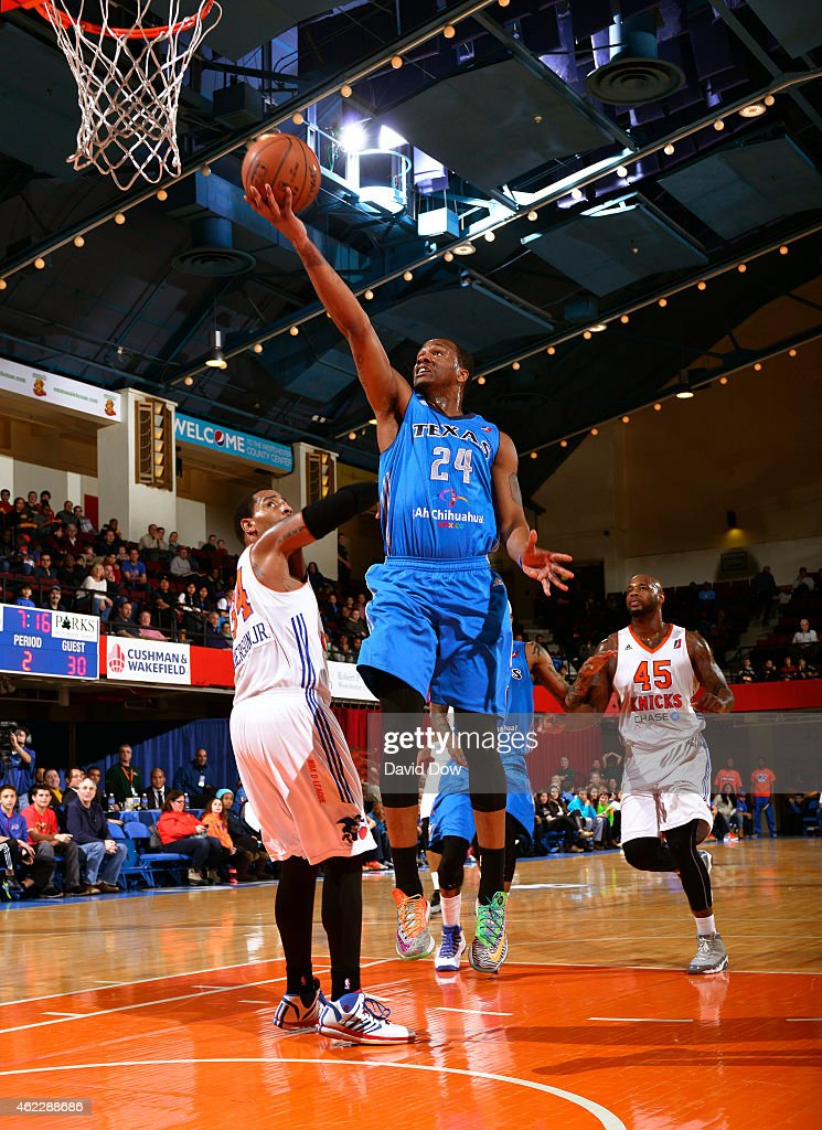 Ivan Johnson of the Texas Legends drives to the basket against the Westchester Knicks at the Westchester County Center on January 24 2015 in...