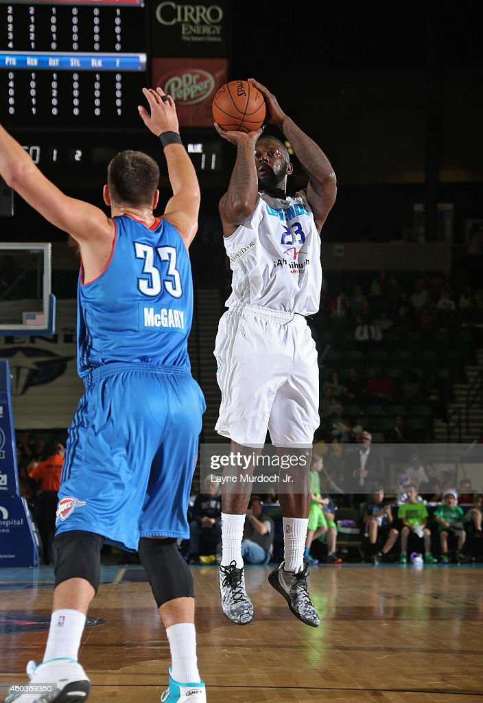 Ivan Johnson of the Texas Legends shoots the ball against the Oklahoma City Blue during an NBDL game on December 5 2014 at the Dr Pepper Arena in...