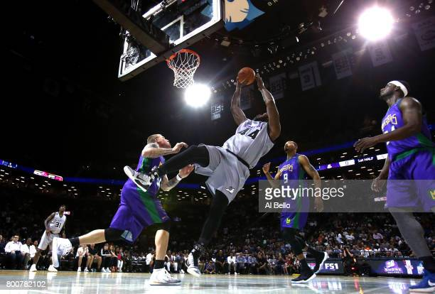 Ivan Johnson shoots against Jason Williams of the 3 Headed Monsters during week one of the BIG3 three on three basketball league at Barclays Center...