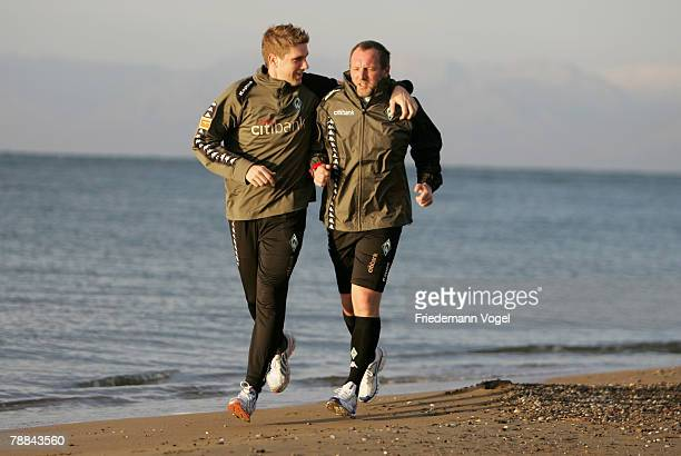 Ivan Klasnic and second coach Matthias Hoenerbach warm up on the beach during the Training Camp of Werder Bremen at the Rixos Hotel on January 9 2008...