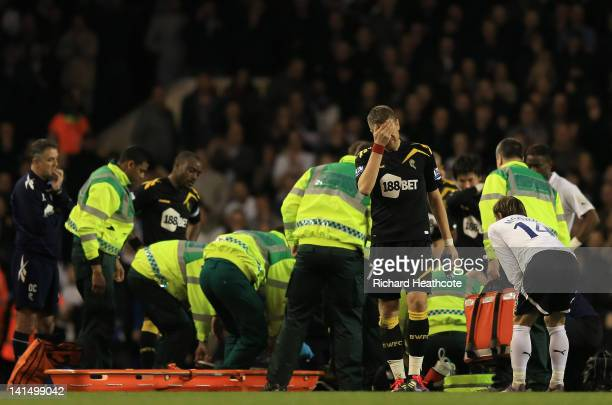 Ivan Klasnic of Bolton Wanderers is distraught as he covers his face as Fabrice Muamba of Bolton Wanderers receives CPR treatment on the pitch after...