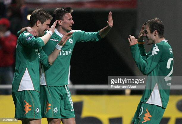 Ivan Klasnic of Bremen celebrates scoring the first goal with Jurica Vranjes and Daniel Jensen during the UEFA Cup round of 32 second leg match...