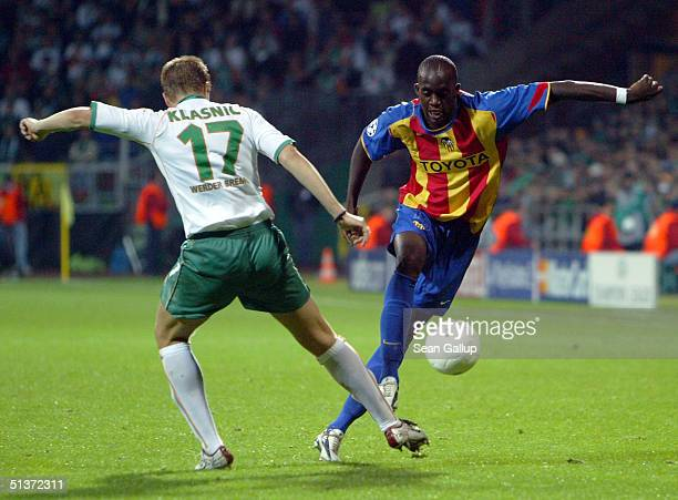 Ivan Klasnic of Werder Bremen vies for the ball against Sissoko of Valencia during the teams' UEFA Champions League Group G match at the Weserstadion...