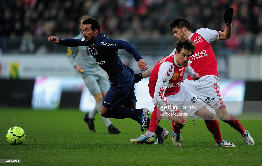 Ivan Lavezzi of Paris SaintGermain battles with Johan Ramare of Stade de Reims Champagne celebrates victory during the Ligue 1 match between Stade de...