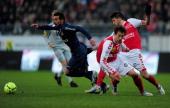 Ivan Lavezzi of Paris SaintGermain battles with Johan Ramare of Stade de Reims Champagne celebrates victory during the Ligue 1 match between Stade de...