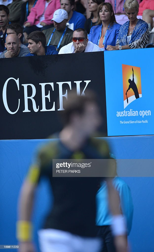 Ivan Lendl, coach Britain's Andy Murray (TOP) watches as he prepares to play during his men's singles match against France's Gilles Simon on the eighth day of the Australian Open tennis tournament in Melbourne on January 21, 2013.