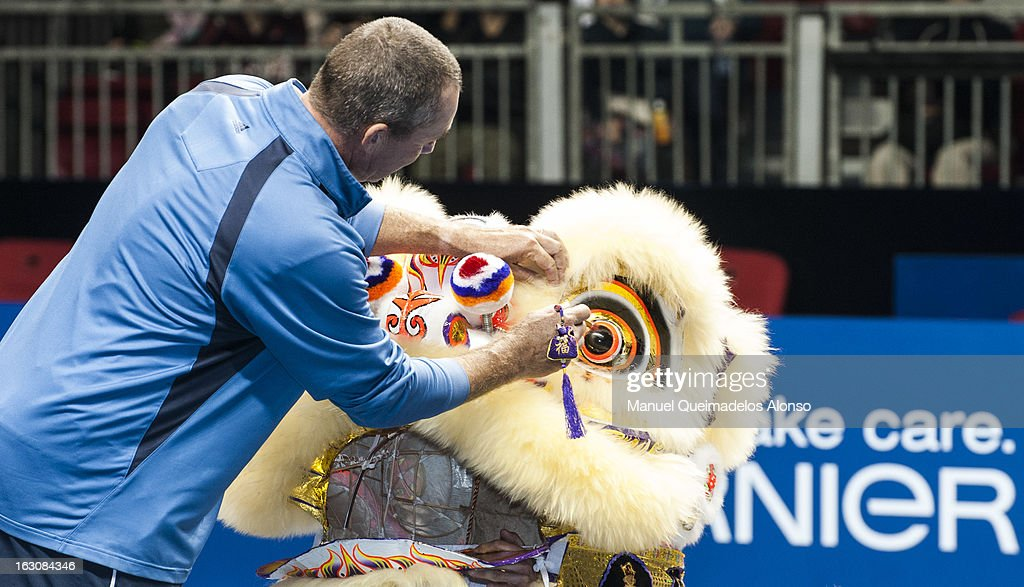 Ivan Lendl dots into the eye of a Chinese Dancing Lion prior his match against John McEnroe as part of the Hong Kong Showdown at the Asia-World Expo on March 4, 2013 in Hong Kong, China.