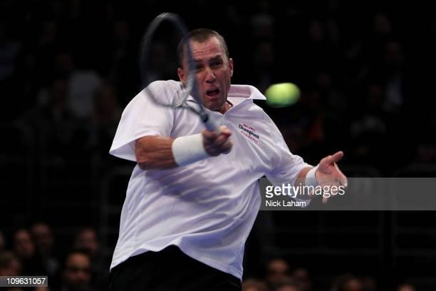 Ivan Lendl hits a return against John McEnroe during the BNP Paribas Showdown at Madison Square Garden on February 28 2011 in New York City