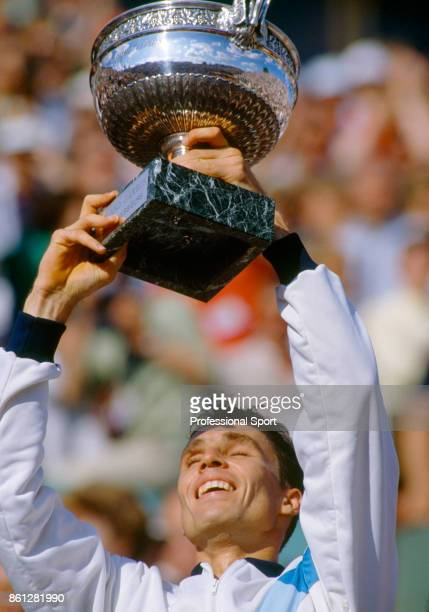 Ivan Lendl of Czechoslovakia celebrates with the trophy after defeating Mikael Pernfors of Sweden in the men's singles Final of the French Open...