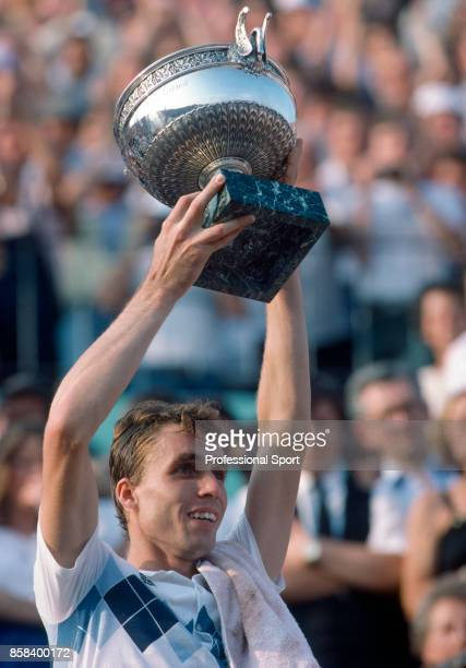 Ivan Lendl of Czechoslovakia celebrates with the trophy after winning his first Grand Slam title by defeating John McEnroe of the USA in the men's...