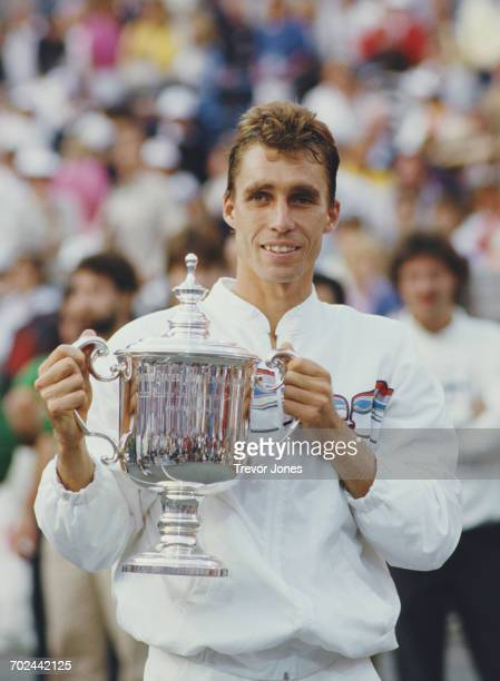 Ivan Lendl of Czechoslovakia holds the trophy after defeating Mikael Pernfors during the Men's Singles Final match at the French Open Tennis...