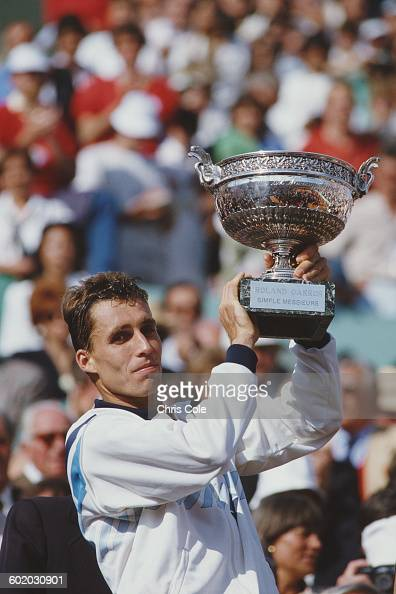 Ivan Lendl of Czechoslovakia holds the trophy aloft after defeating Mikael Pernfors during the Men's Singles Final match at the French Open Tennis...