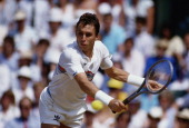 Ivan Lendl of Czechoslovakia reaches to make a return against Pat Cash during their Men's Singles Final match at the Wimbledon Lawn Tennis...