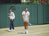 Ivan Lendl of the United States prepares to serve as his coach Tony Roche looks on during practice for the Wimbledon Lawn Tennis Championship on 5...