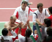 Ivan Ljubicic celebrates with his teammates with Mario Ancic of Croatia after winning the doubles match against Michal Mertinak and Dominik Hrbaty of...