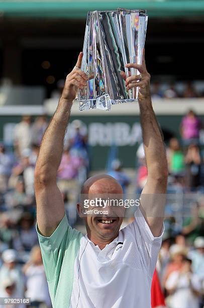 Ivan Ljubicic of Croatia poses with the trophy following his victory over Andy Roddick during the men's final of the BNP Paribas Open at the Indian...