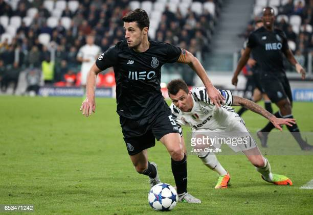 Ivan Marcano of FC Porto and Mario Mandzukic of Juventus in action during the UEFA Champions League Round of 16 second leg match between Juventus...