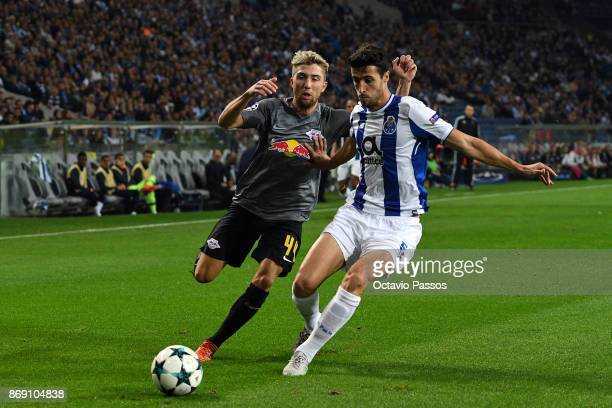 Ivan Marcano of FC Porto competes for the ball with Kevin Kampl of RB Leipzig during the UEFA Champions League group G match between FC Porto and RB...