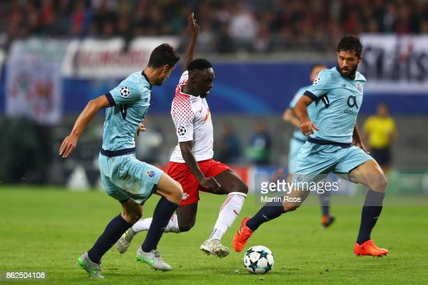 Ivan Marcano of FC Porto JeanKevin Augustin of RB Leipzig and Felipe of FC Porto battle for posession during the UEFA Champions League group G match...
