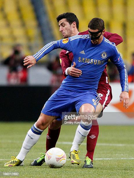 Ivan Marcano of FC Rubin Kazan is challenged by Fernando Torres of Chelsea FC during the UEFA Europa League quarter final second leg match between FC...