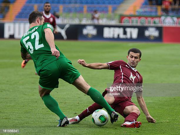 Ivan Marcano of FC Rubin Kazan is challenged by Martin Jiranek of FC Tom Tomsk during the Russian Premier League match between FC Rubin Kazan and FC...