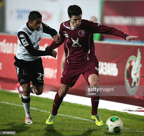 Ivan Marcano of FC Rubin Kazan is challenged by Ricardo Laborde of FC Krasnodar Krasnodar during the Russian Football League Championship match...