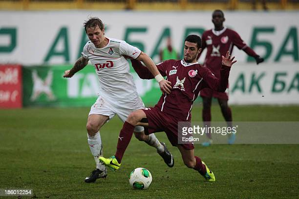Ivan Marcano of FC Rubin Kazan is challenged by Roman Pavlyuchenko of FC Lokomotiv Moscow during the Russian Football League Championship match...