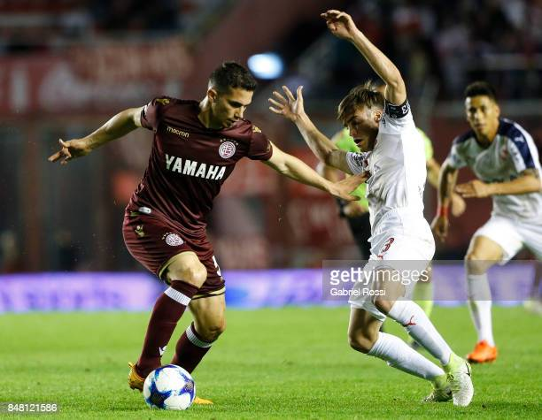Ivan Marcone of Lanus fights for the ball with Nicolas Tagliafico of Independiente during a match between Independiente and Lanus as part of the...